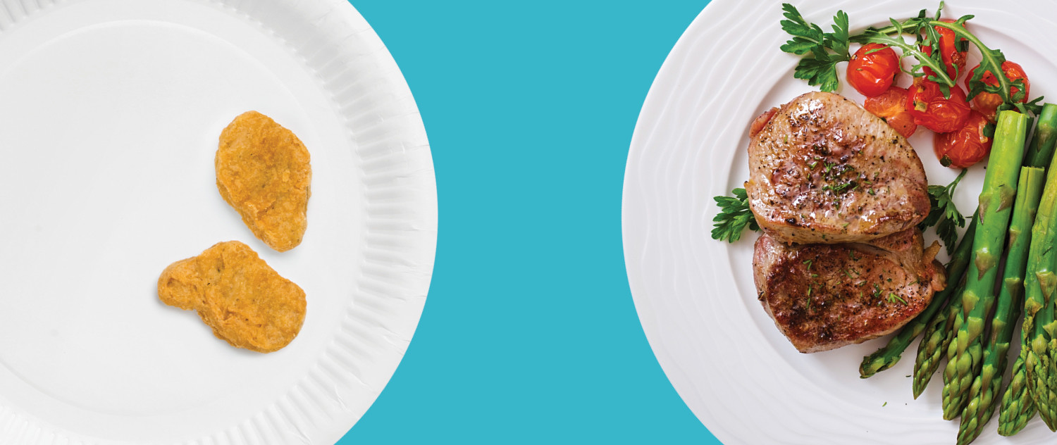 two plates with food of different quality and quantity