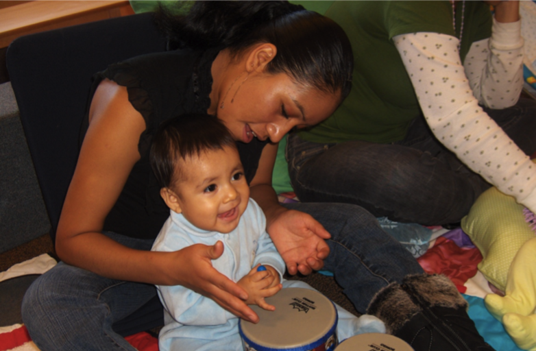 child mother playing drums