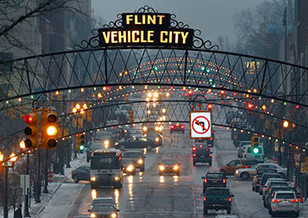 "Downtown Flint with sign, ""Flint Vehicle City"""