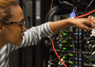 Rebecca Yohannes inspecting the HPC at Mailman
